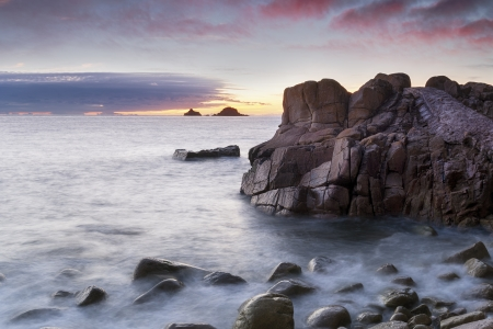 Sunset at Porth Nanven Cove near Lands End in Cornwall photo