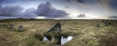 bodmin: Winter sunrise at Stannon Stone Circle on Bodmin Moor in Cornwall with Roughtor in the far distance. Stock Photo