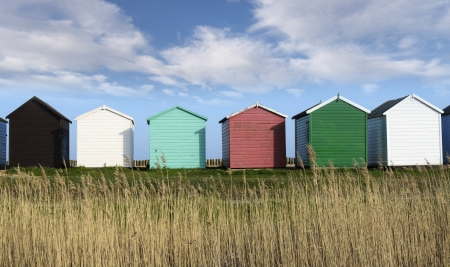 Colorful Beach huts at Calshot on the Solent near Southampton in Hampshire Stock Photo