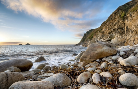 The beach at Porth Nanven Cove near Lands End in Cornwall photo