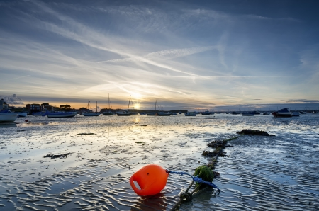 Sunset and boats at the beach at Sandbanks in Poole Harbour in Dorset Stock Photo