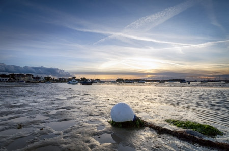 Sunset and boats at the beach at Sandbanks in Poole Harbour in Dorset photo