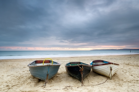 bournemouth: Boats at Durley chine on Bournemouth beach in Dorset