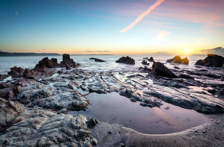 Rock pools on the beach at Looe in Cornwall