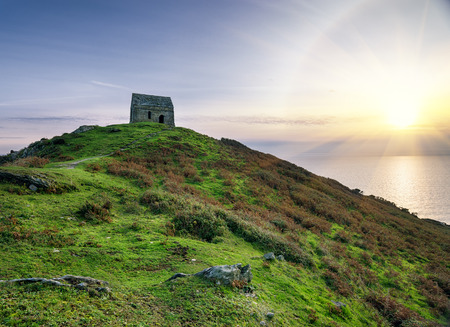 Ruined chapel on hill at Rame Head in Cornwall photo