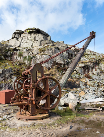 Rustly old winch crane used in a stone quarry photo