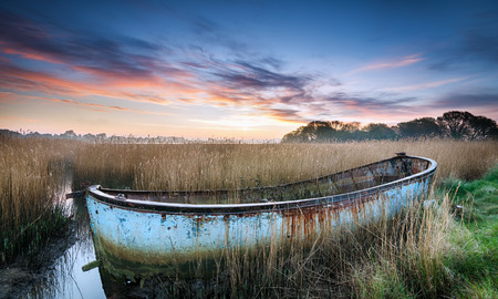 salt marsh: Sunrise over a shipwrecked boat in the backwaters of Poole Harbour in Dorset