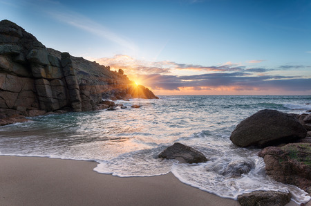 Sunrise at Porthgwarra Cove on the Lands End Peninsula in Cornwall Stock Photo