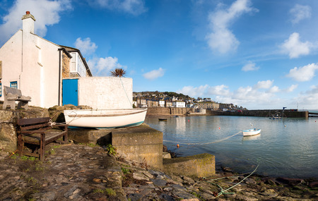 mousehole: The harbour at Mousehole near Penznace in Cornwall Stock Photo