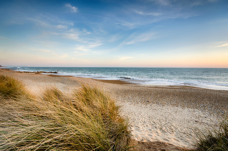 The beach and sand dunes at Hengistbury Head near Bournemouth in Dorset  版權商用圖片