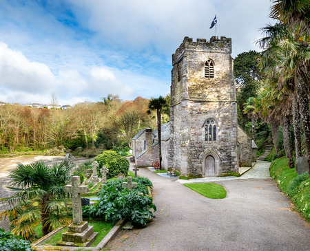churchyard: The Jurch at St-Just-in-Roseland, built in the 13th Century and perched on the edge of a tidal creek on the Roeseland Peninsula in Cornwall Stock Photo