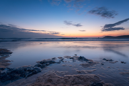 Beuatiful sunset on a sandy beach at Constantine Bay near Padstow in Cornwall photo