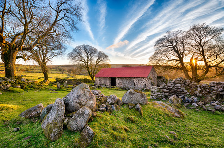 Red roofed old barn at Emsworthy on Dartmoor National Park in Devon