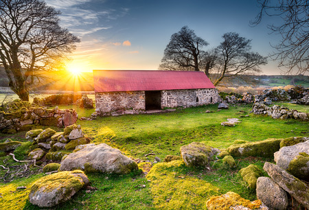 croft: Old barn or croft with a red tin roof at Emsworthy on Dartmoor National Park in Devon