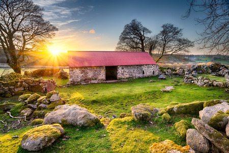 Old barn with a red tin roof at Emsworthy on Dartmoor National Park in Devon Stock Photo