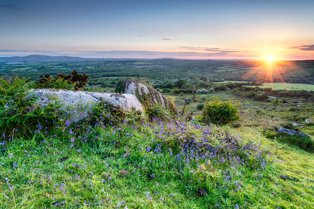 bodmin: Sunset at Helman Tor a rocky area of rugged moor in near Bodmin Cornwall Stock Photo