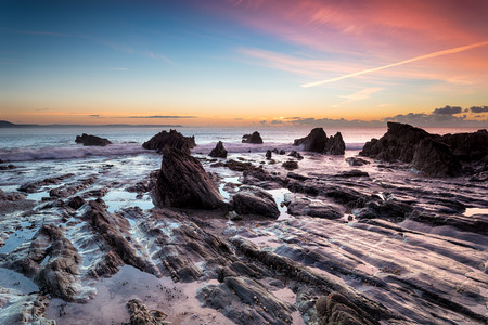 Sunrise on the south Cornish coast at Looe photo