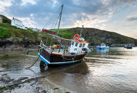 Fishing boats on the beach at Port Isaac on the north Cornwall coast photo