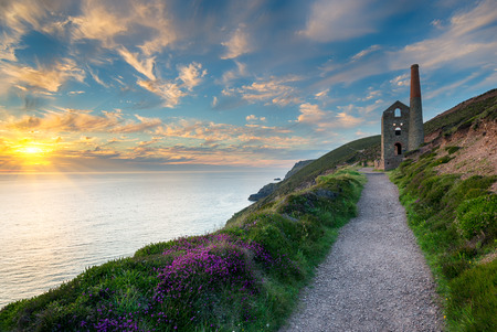 The iconic ruins of the Wheal Coates engine house perched on cliffs on the Cornwall coast at St Agnes photo