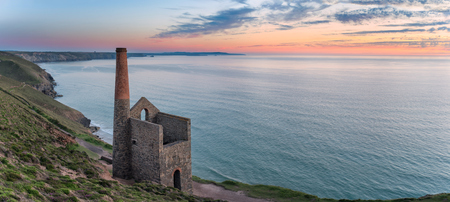 The ancient ruins of an engine house left over from the days of tin mining, perched on cliffs at Wheal Coates near St Agnes on the Cornwall coast photo