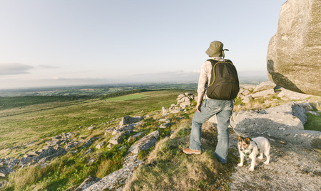 bodmin: Woman hiking on Bodmin Moor in Cornwall with dog.