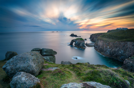 A long exposure of sunset at Lands End in Cornwall looking out towards the Long Ships lighthouse photo