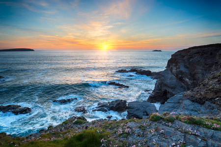 Sunset at Longcarrow Cove near Padstow in Cornwall photo