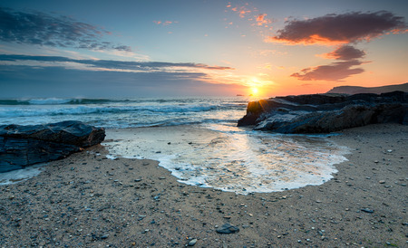 Sunset at Boobys Bay a small cove at the norhtern end of Constantine Bay near Padstow in Cornwall photo