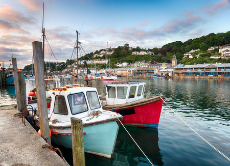 Fishing boats in the harbour at Looe on the south coast of cornwall Фото со стока