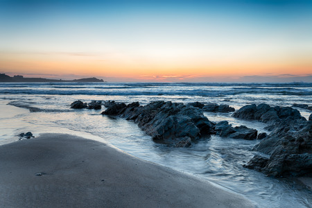 Sunset on Lusty Glaze beach at Newquay in Cornwall