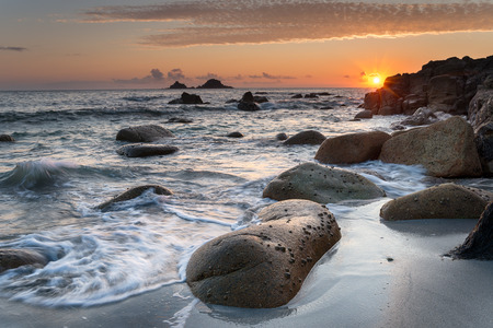 Sunset at Porth Nanven Beach in Cot Valley near Penzance in Cornwall photo