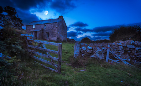 frightening: Creepy derelict haunted house under a full moon