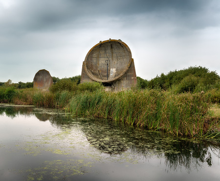parabolic mirror: A forerunner to radar these sound mirrors were used during world war 2 to detect aircraft crossing the English Channel Stock Photo