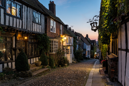 half  timbered: Half timbered Tudor houses on a cobbled street at dusk in Rye, East Sussex
