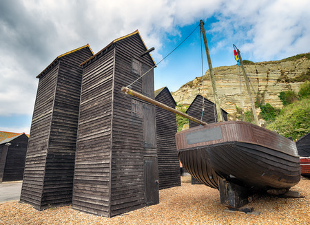 hastings: Tall thin traditional wooden fishing net huts on the harbour at the Stade in Hastings, East Sussex