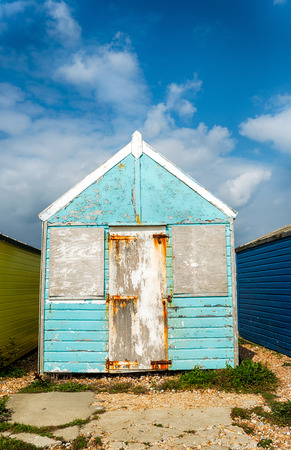 tatty: Tatty unloved old blue beach hut Stock Photo