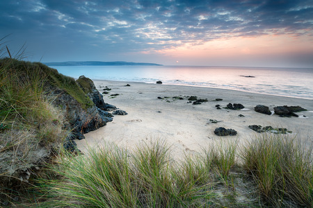 Sunset over the beach at Hayle in Cornwall from the sand dunes at Gwithian Towans photo