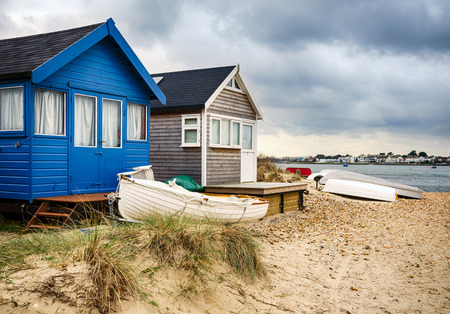 hengistbury: Beach huts and boats in sand dunes at Mudeford Spit on Hengistbury Head near Christchurch in Dorset
