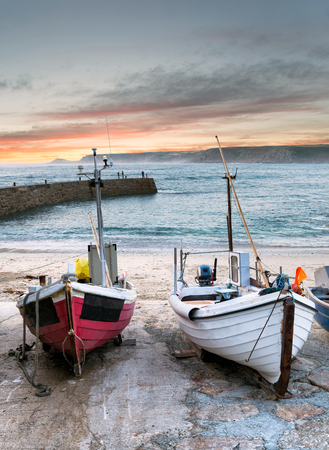 Fishing boats on the beach at Sennen Cove near Lands End in Cornwall photo