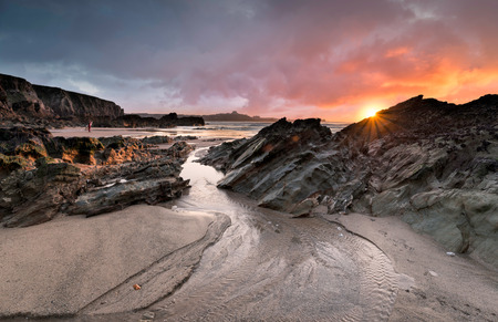 Sunset at Lusty Glaze beach at Newquay in Cornwall photo