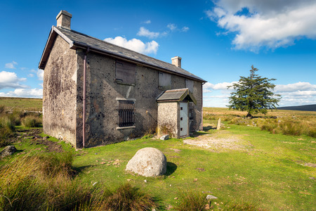 abandoned farmhouse abandoned farmhouse: A derelict and abandoned farmhouse at Nuns Cross a remote part of Dartmoor National Park near Princetown in Devon
