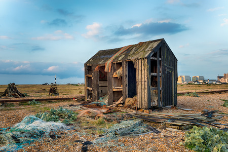 kent: An abandoned fishermans hut fallen into ruin and disrepair on Dungeness beach in Kent