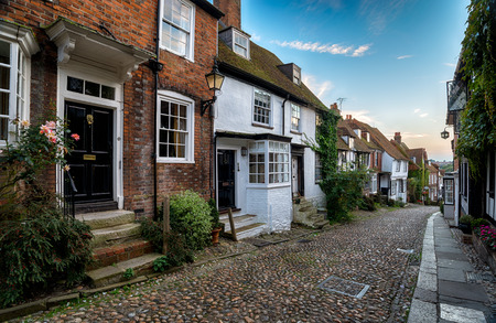 Picturesque cottages on a cobblestone street in the town of Rye in East Sussex photo