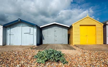 hastings: A row of beach huts on a shingle beach at St Leonards on Sea in Hastings, East Sussex