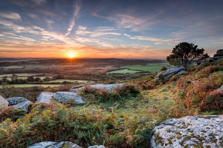 bodmin: A beautiful Autumn sunrise from Helman Tor a rocky outcrop of rugged moorland and granite near Bodmin in Cornwall Stock Photo