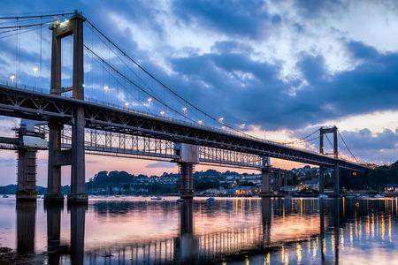 Dusk at the Tamar Bridge, a suspension bridge crossing the river Tamar dividng Devon and Cornwall photo