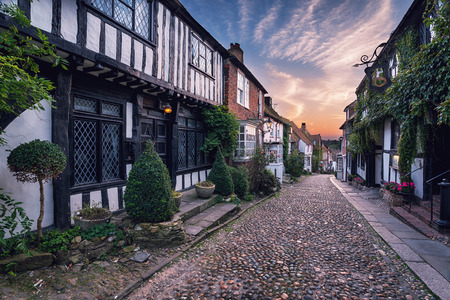 Beautiful tudor style half timbered houses lining a cobbled street in Rye, Sussex, retro vintage effect. photo