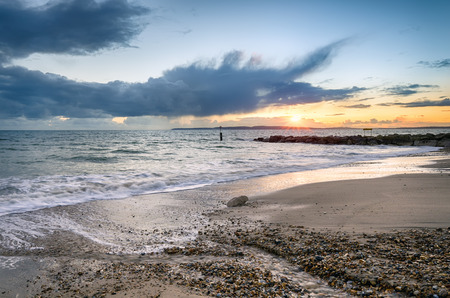 hengistbury: Sunset on Solent Beach at Southbourne in Bournemouth, Dorset