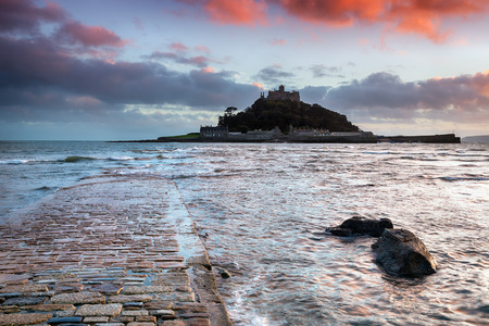 Sunset at the causeway at high tide leading to St Michaels Mount at Marazion near Penzance in Cornwall photo