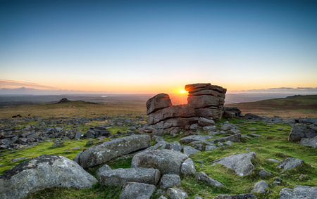 granite park: Sunset at Staple Tor a weathered granite rock formation on Dartmoor National Park in Devon Stock Photo